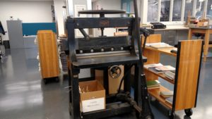"""The lab possesses a Chandler & Price Company """"guillotine,"""" a word commonly used in the industry for machines that cut pasteboard and trim books. The Cleveland-based company was best known for manufacturing jobbing presses."""