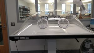 A humidification dome allows materials to be processed with regulated moisture, such as may be required for flattening brittle papers. The dome sits atop a suction table which allows the conservator to force solvents into the paper.