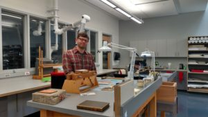 Justin Johnson, the library's Senior Conservator, is at one of several work stations in the lab's 4,000 square feet. The new facility is twice the size of the old lab.