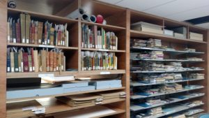 Library materials, with job tickets attached, await their turn in the Conservation Lab.